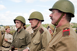 "Re-enactors portray a Soviet soldier from the Russian 13th Guards Rifle Division ""Poltavaskaya"" during the ""Spam 1940s Wartime Weekend"" at the Ponderosa in Heckmondwike<br />
