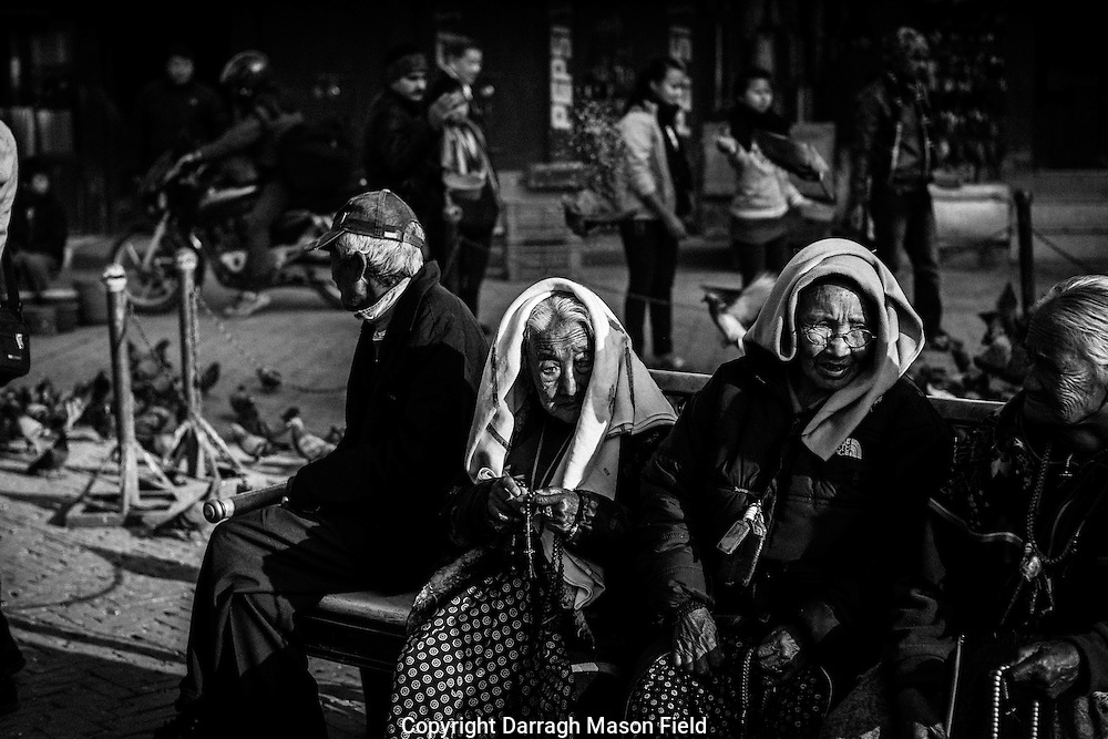 Old pilgrim women at Boudhanath Stupa, Kathmandu, Nepal
