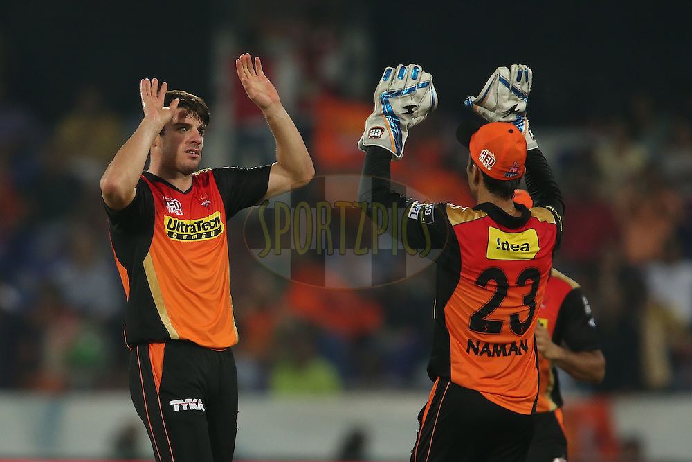 Moises Henriques of Sunrisers Hyderabad and Naman Ojha of Sunrisers Hyderabad celebrate getting Faf du Plessis of Rising Pune Supergiants wicket during match 22 of the Vivo IPL 2016 (Indian Premier League) between the Sunrisers Hyderabad and the Rising Pune Supergiants held at the Rajiv Gandhi Intl. Cricket Stadium, Hyderabad on the 26th April 2016<br /> <br /> Photo by Shaun Roy / IPL/ SPORTZPICS