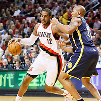 02 December 2013: Portland Trail Blazers power forward LaMarcus Aldridge (12) drives past Indiana Pacers power forward David West (21) during the Portland Trail Blazers 106-102 victory over the Indiana Pacers at the Moda Center, Portland, Oregon, USA.
