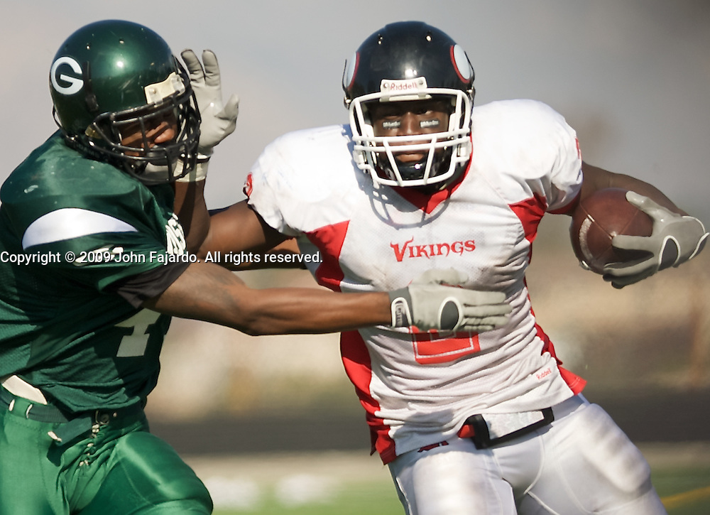 Darrius Young pushes Kyle Monson(l) away in the game against Grossmont College, El Cajon CA, Saturday Oct. 10, 2009.