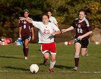 Pittsfield's Jen Tyrell signals her teammate as she takes control of the ball from Sophia Allard of Derryfield during NHIAA Division IV varsity soccer action Tuesday afternoon at Drakes Field.  (Karen Bobotas/for the Concord Monitor)