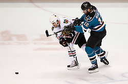 May 18, 2010; San Jose, CA, USA; San Jose Sharks center Patrick Marleau (12) checks Chicago Blackhawks center Dave Bolland (left) during the first period of game two of the western conference finals of the 2010 Stanley Cup Playoffs at HP Pavilion.  The Blackhawks defeated the Sharks 4-2. Mandatory Credit: Jason O. Watson / US PRESSWIRE