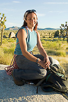 Climber on Boulder with Gear
