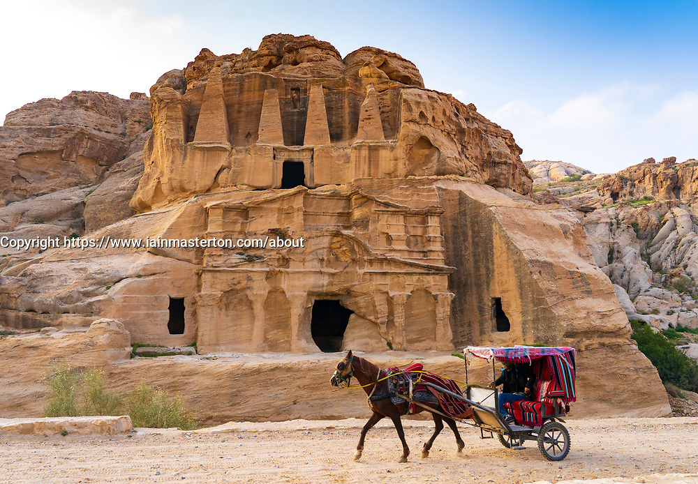 A horse a trap passes the Obelisk Tomb in Petra, Jordan. Work heritage site