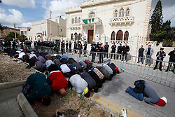Protestors pray during a protest outside the Libyan Embassy in Attard, outside Valletta, February 22, 2011. The protest was organised by the Libyan community living in Malta against the Libyan government's crackdown on demonstrators in Libya..Photo by Darrin Zammit Lupi