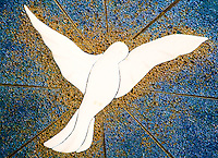 Ticino, Southern Switzerland. Simple but beautiful dove in a stained glass window.
