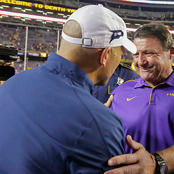 Aug 31, 2019; Baton Rouge, LA, USA; LSU Tigers head coach Ed Orgeron talks with Georgia Southern Eagles head coach Chad Lunsford following the game at Tiger Stadium. Mandatory Credit: Derick E. Hingle-USA TODAY Sports