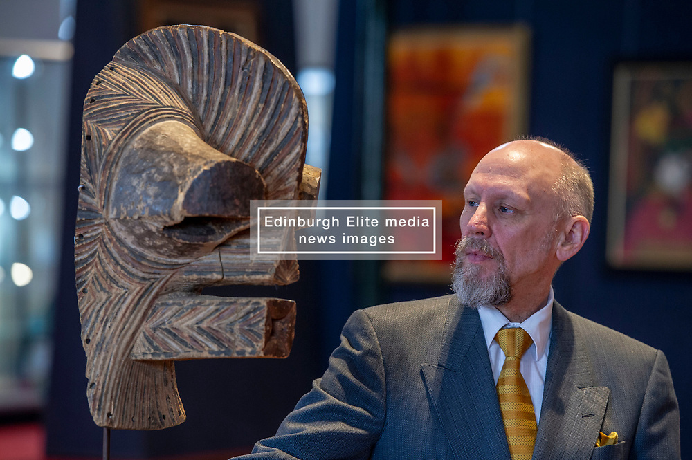 Pictured: Pete Haley models for a life art class with a Songya Mask, Kifwebe Democratic Republic of Congo <br /> <br /> A coconut collecting box valued at GBP500-GBP700, once in the possession of Scottish missionary John Paton, is among the highlights of the African & Oceanic Sale which takes place on 1 May.<br /> <br /> Ger Harley | EEm 29 April 2019
