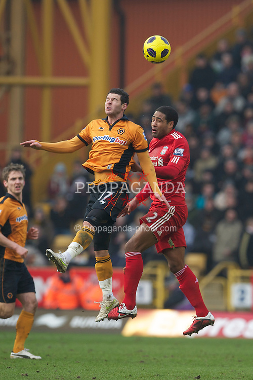 WOLVERHAMPTON, ENGLAND - Saturday, January 22, 2011: Liverpool's Glen Johnson and Wolverhampton Wanderers' Matthew Jarvis during the Premiership match at Molineux. (Photo by David Rawcliffe/Propaganda)