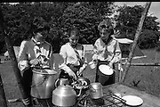 300 Girl Guides At Larch Hill.  (R84)..1988..25.07.1988..07.25.1988..25th July 1988..As part of the Diamond Jubilee celebrations the girl guide movement organised a friendship camp for 300 girls.The friendship camp was set up in the grounds of Larch Hill, Tibradden,Co Dublin. The camp will run from 23rd July to 30th July...Image shows some of the guides preparing breakfast before the start of a busy day.