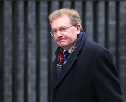 © Licensed to London News Pictures. 01/12/2015. London, UK Secretary of State for Scotland DAVID MUNDELL arrives for a Cabinet meeting ahead of a vote in Parliament on bombing IS targets in Syria. Photo credit: Peter Macdiarmid/LNP