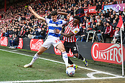Queens Park Rangers Midfielder Pawel Wszolek (23) and Brentford Midfielder Moses Odubajo (2) battle for the ball during the EFL Sky Bet Championship match between Brentford and Queens Park Rangers at Griffin Park, London, England on 2 March 2019.