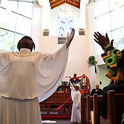 Jan. 16, 2011. Miami, FL. Leia Ambrister, 11, performs a liturgical dance with Sanaya Clinch, 7, during the 18th annual celebration in memory of Rev. Dr. Martin Luther King, Jr. Lottie Person shows her support for the performance from the pew by the aisle. Members of the Coconut Grove community gathered at Great St. Paul AME Church Sunday, Jan. 16, to celebrate. The service was dedicated to the restoration of The Mariah Brown House in the Grove. Overall, the community was able to raise during the service about $1,000 to be used for preserving the structure. Photo by Brittney Bomnin