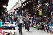 Muslim couple shopping in The Grand Bazaar, Kapalicarsi, great market in Beyazi, Istanbul, Turkey