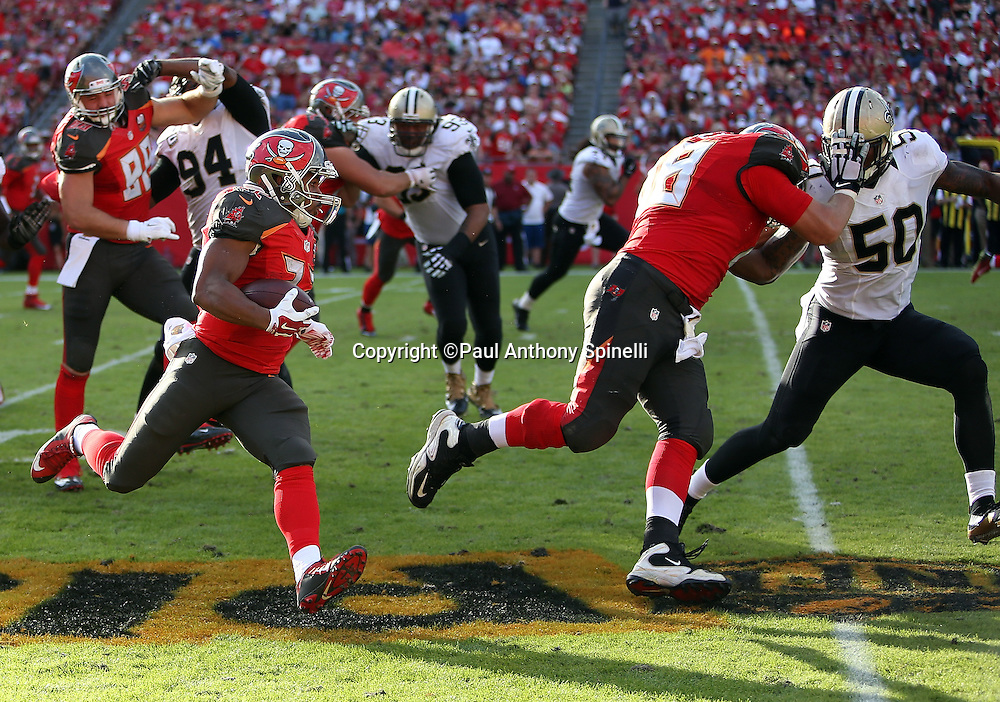 Tampa Bay Buccaneers running back Doug Martin (22) follows a lead block on New Orleans Saints rookie middle linebacker Stephone Anthony (50) by Tampa Bay Buccaneers center Joe Hawley (68) as he runs for a fourth quarter gain of 24 yards to the Bucs 44 yard line during the 2015 week 14 regular season NFL football game against the New Orleans Saints on Sunday, Dec. 13, 2015 in Tampa, Fla. The Saints won the game 24-17. (©Paul Anthony Spinelli)