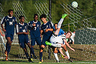 Rice's Nate Cary (9) kicks the ball during the boys soccer game between the The Burlington Seahorses and the Rice Green Knights at Rice Memorial high School on Tuesday afternoon September 15, 2015 in South Burlington, Vermont. (BRIAN JENKINS/for the FREE PRESS)