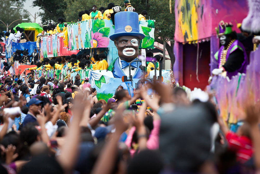 Float in the Zulu Parade pass through a crowd on Fat Tuesday, Mardi Gras Day in New Orleans in 2011
