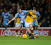 3rd November 2018, Fir Park, Motherwell, Scotland; Ladbrokes Premiership football, Motherwell versus Dundee; Paul McGowan of Dundee challenges for the ball with Allan Campbell of Motherwell