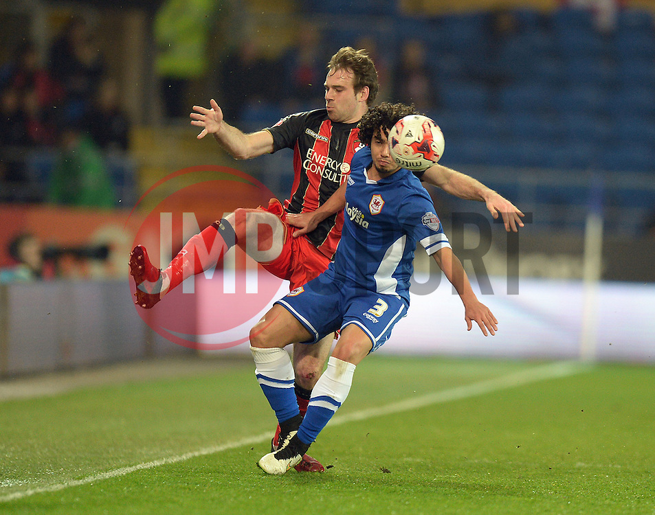 Bournemouth's Brett Pitman battles for the ball with Cardiff City's Fabio - Photo mandatory by-line: Alex James/JMP - Mobile: 07966 386802 - 17/03/2015 - SPORT - Football - Cardiff - Cardiff City Stadium - Cardiff City v AFC Bournemouth - Sky Bet Championship