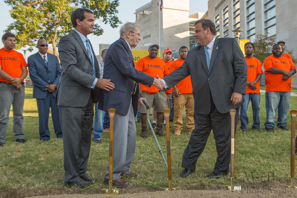 NJ Governor Chris Christie shakes hands with Henry Rowan (center) at the Rowan Hall Expansion Groundbreaking at Rowan University  in Glassboro, NJ on Wednesday October 2, 2013. (photo / Mat Boyle)
