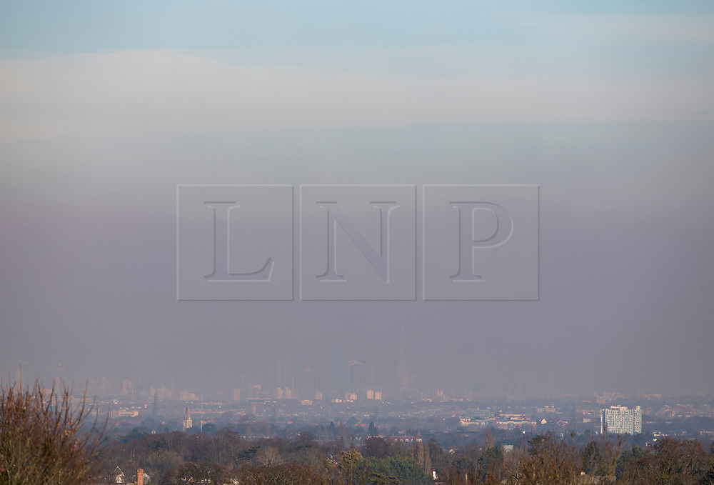 © Licensed to London News Pictures. 19/01/2017. London, UK. Blue sky is seen above trapped pollution over central London. London Mayor Sadiq Khan has issued an air quality alert for parts of central London - with a peak today in certain areas including Westminster and the City. Temperatures are not expected to rise above 1 degree in the south east today. Photo credit: Peter Macdiarmid/LNP