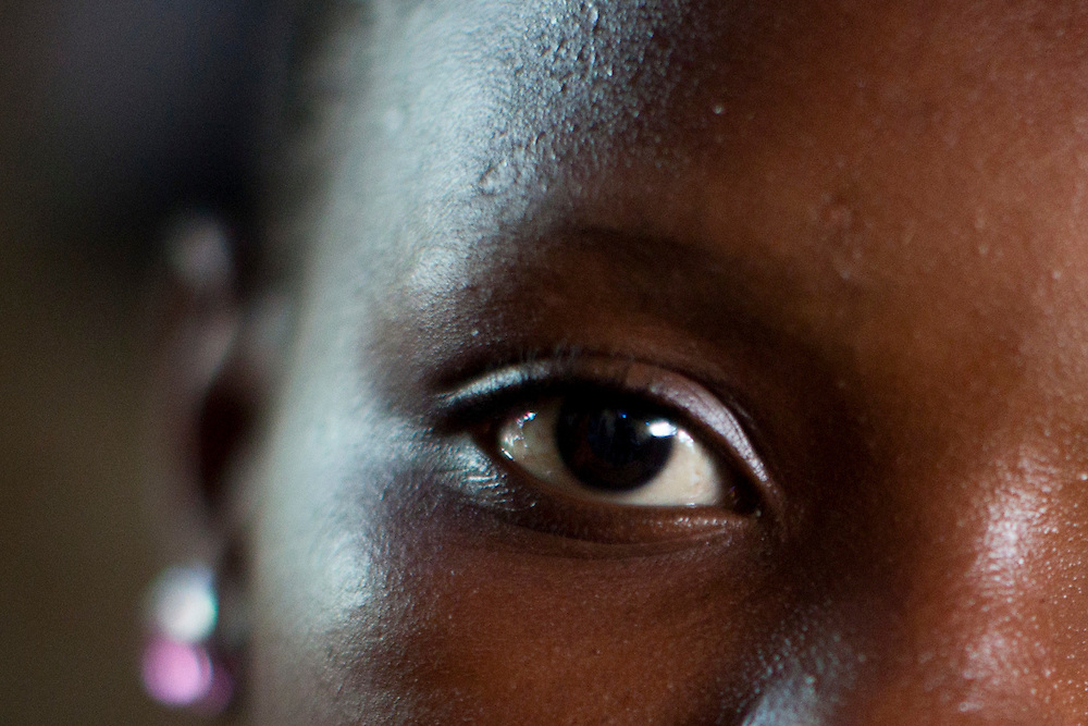 Angelie, age 14, poses for a portrait on July 14, 2010 in Port-au-Prince, Haiti. She was raped by four men and two women, all of whom she knew, this past Saturday. It happened when they invited her into their home and offered her food. While she has reported the crime to the police, no arrests have been made.
