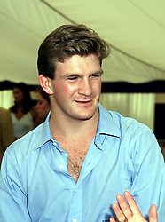 The HON.PEREGRINE HOOD son of Viscount Bridport, at a polo match in Berkshire on 25th July 1999.MUM 137