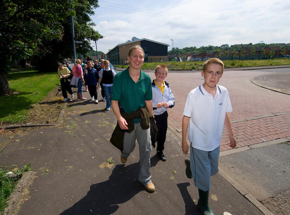 Children and leader leaving primary school on way to Forest School in Garscaden Woods