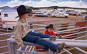 05 AUGUST 2000 - WILLIAMS, AZ: A pair of young cowboys sit above the livestock chutes and wait for the action to begin at the 22nd Annual Cowpunchers' Reunion Rodeo in Williams, Arizona, Aug 5.  The Cowpunchers' Reunion Rodeo is held for working cowboys from the ranches in Arizona and the region. PHOTO BY JACK KURTZ