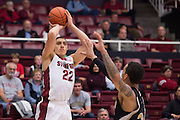 November 14, 2014; Stanford, CA, USA; Stanford Cardinal forward Reid Travis (22) shoots the basketball against Wofford Terriers forward Lee Skinner (34) during the first half at Maples Pavilion.