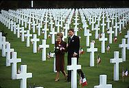 President Reagan and First Lady Nancy Reagan walk through the graves at the US cemetary in Normandy on the fortieth anniversary of D Day.<br /> <br /> Photograph by Dennis Brack bb 27