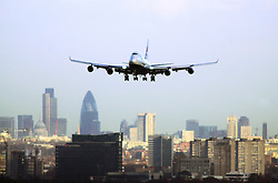 747 over London skyline. Comission shoot for BAA Annual Report. Shot from the LHR control tower roof before comission. Picture David Poultney