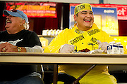 Gino Lopez competes in a wing eating contest during ZestFest at the Irving Convention Center on Saturday, January 26, 2013 in Irving, Texas. (Cooper Neill/The Dallas Morning News)