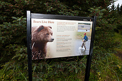 National Park Service sign warning fishermen and hikers of North American brown bears /  coastal grizzly bears (Ursus arctos horribilis), Lake Clark National Park, Alaska, United States of America