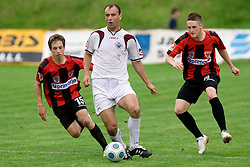 Zeljko Mitrakovic between Sasa Aleksander Zivec and  Nejc Vidmar at football match between NK Primorje Ajdovscina and NK Triglav Gorenjska of Second Slovenian football league, on May 16, 2010 in Vipava, Slovenia. Primorje placed first in 2.SNL and qualified for  PrvaLiga in season 2010/2011. (Photo by Urban Urbanc / Sportida)