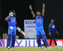 August 20, 2017 - Dambulla, Sri Lanka - Indian cricketer Shikhar Dhawan celebrates after scoring  hundred runs as Indian captain Virat Koli(L) looks on during the 1st One Day International cricket match bewtween Sri Lanka and India at Dambulla International cricket stadium situated in the Central Province and the first and only International cricket ground in the dry zone of Sri Lanka on Sunday 20 August 2017. (Credit Image: © Tharaka Basnayaka/NurPhoto via ZUMA Press)