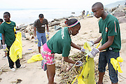Brian Shange (r) and Ayanda Mbuyazi participate in the beach clean up organized by the Southern Durban Community Environmental Alliance (SCDEA)/KZN, 1 December 2011
