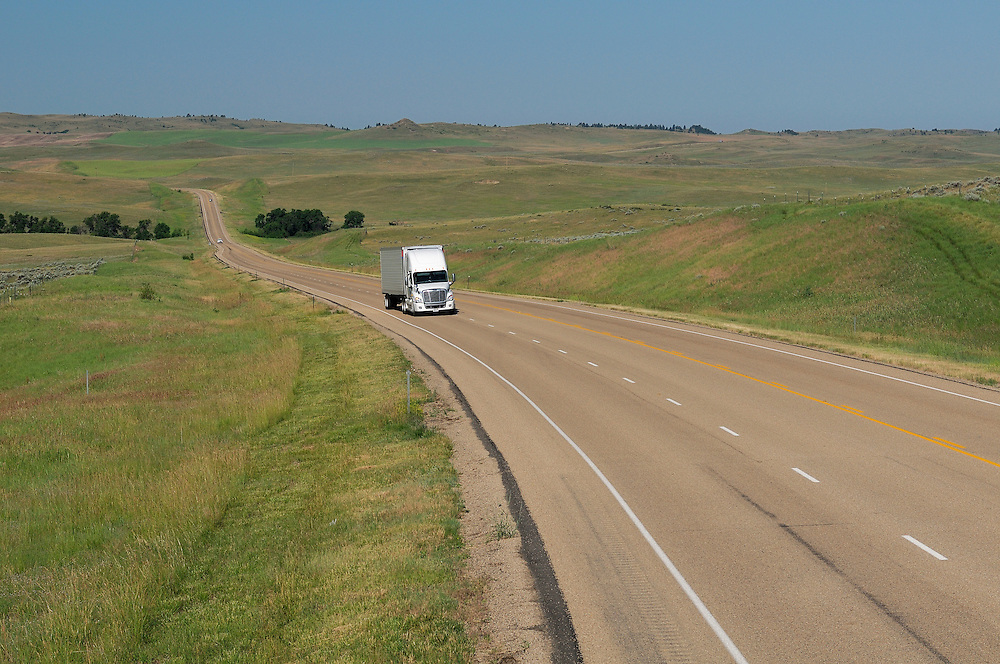 Truck on Highway 212 near Crow Agency, Crow Indian Reservation,  Montana, USA