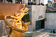 FEBRUARY 27, 2011 - MANHATTAN - Golden statue of Prometheus from side and front, at Rockefeller Center Plaza Concourse outdoor Ice Staking Rink ,midday on February 27, 2011 in New York City, NY, USA.  (EDITORIAL USE ONLY)