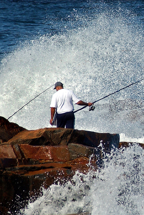 Gloucester: .Alceu Franzoloso, of Everett, fishes for stripers off Bass Rocks Monday afternoon.Photo by Mike Dean/Gloucester Daily Times. Sunday, September 19, 2004