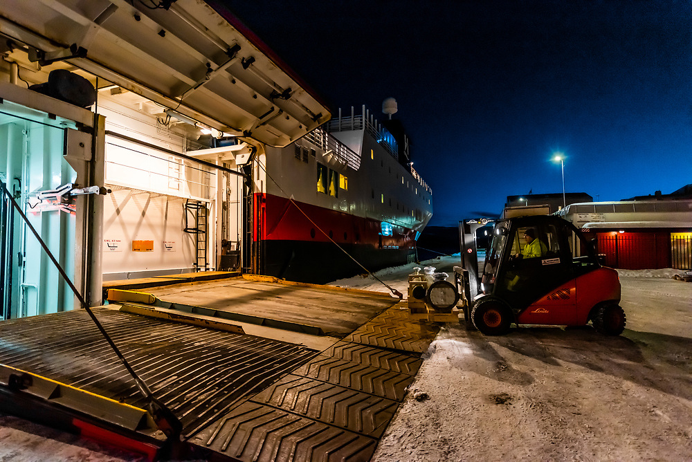 Freight is unloaded from the Hurtigruten ship MS Vesteralen at the port of Molde, Norway.