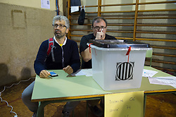 &copy; Licensed to London News Pictures. 01/10/2017. Barcelona, Spain.  <br /> <br /> Members of the organization during the voting at Sedeta de Gracia&acute;s Centre Civic poll station.<br /> <br /> Students, their parents, associations and neighbours have organized to carry out &quot;playful activities&quot; during the weekend and keep open the Sedeta de Gracia&acute;s Centre Civic.<br />  <br /> Since early in the morning dozens of people wait at the college&acute;s door for the voting time under the rain.<br /> <br /> Mossos d&acute;Escuadra said they won&acute;t do nothing if that can destabilize social order.<br /> <br /> Catalonia is awaiting for today, October 1st, when the Spanish Region wants to vote in a self-determination referendum to get a independence.<br /> <br /> The Referendum&acute;s Law was passed on last September 6th at the Catalonian Parliament thanks to the votes of &quot;Junts pel Sí&quot; and &quot;CUP&quot;. Then it was suspended by the Spanish Constitutional Court, on next day.<br /> Carles Puigdemont, the President of the Government of&nbsp;Catalonia, said he would ignore that and he and his Government will continue with the Referendum.<br /> <br /> The Spanish Government has sent to Catalonia thousands of &quot;Guardia Civil&quot; and &quot;Policía Nacional&quot; officers (two of the Spanish forces and state security forces), to enforce the ruling of the Constitutional Court and avoid the voting process on next Sunday. They will work with the Mossos d&acute;Escuadra (the Autonomic police in Catalonia).<br /> <br /> To avoid the vote, the Spanish Government has prevented the opening of polling stations, some of which are schools.  <br /> <br /> Photo credit: Gustavo Valiente/LNP