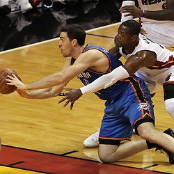 Jun 19, 2012; Miami, FL, USA; Oklahoma City Thunder power forward Nick Collison (4) passes against Miami Heat shooting guard Dwyane Wade (3) during the first quarter in game four in the 2012 NBA Finals at the American Airlines Arena. Mandatory Credit: Derick E. Hingle-US PRESSWIRE
