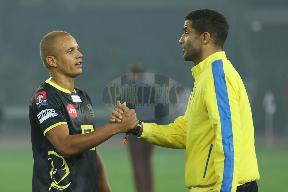 Kerala Blasters FC  players congratulating each other after winning the match  during match 43 of the Hero Indian Super League between Delhi Dynamos FC and Kerala Blasters FC  held at the Jawaharlal Nehru Stadium, Delhi, India on the 10th January 2018<br /> <br /> Photo by: Saikat Das  / ISL / SPORTZPICS