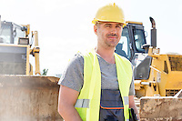 Portrait of confident supervisor standing at construction site