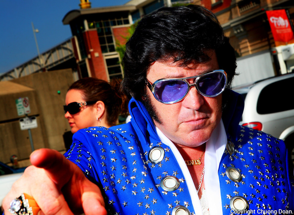 "August 11, 2006. Kansas City, MO. .Kansas City hosted the 19th Annual Elvis Parade, the worlds largest, at Barney ""Elvis"" Plaza in downtown. The parade features dozens of Elvis impersonators and wacky entertainment like the Canonball Elvis.."