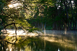 Stock photo of an early morning fog on the Frio River in the Texas Hill Country