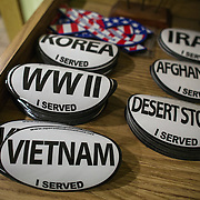 TAKOMA PARK, MD  - JAN 25: Free military bumper stickers at the local VFW post in Takoma Park, Maryland, January 25, 2014. VFW Posts are dying all across the country but in the unlikely liberal haven of Takoma Park, the old VFW is showing signs of life. By throwing open the doors to private parties and concerts, the club is breaking even in spite of dwindling membership. Several times a month, the bar dwelling regular vets are sharing space with the bureaucrats, activists and peaceniks from the surrounding neighborhood. (Photo by Evelyn Hockstein/For The Washington Post)