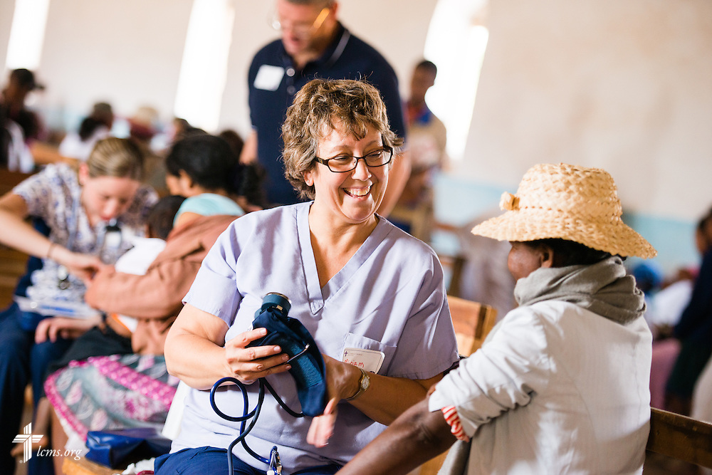 Miriam Wilson greets a patient during the Mercy Medical Team clinic on Saturday, Oct. 18, 2014, at a Fiangonana Loterana Malagasy (FLM) Lutheran church in Antsoantany, Madagascar. LCMS Communications/Erik M. Lunsford